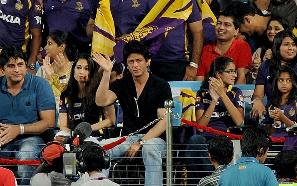 Bollywood star Shah Rukh Khan (C) waves