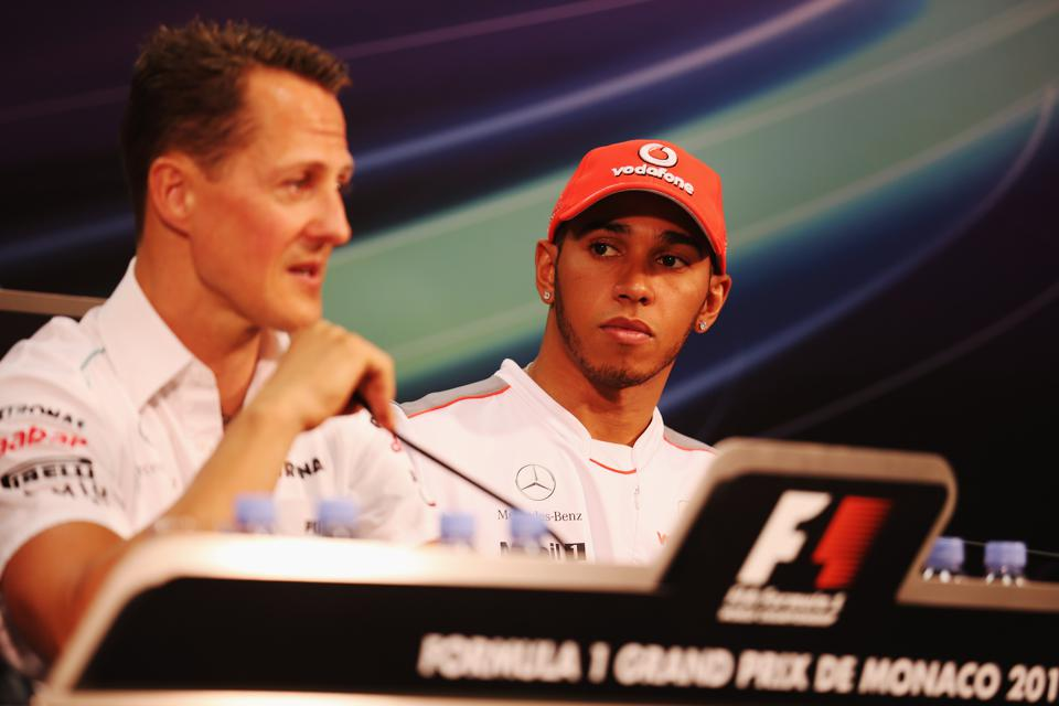 Lewis Hamilton (right) is on track to equal the record set by legendary driver Michael Schumacher, seen here on the left (Clive Mason/Getty Images)
