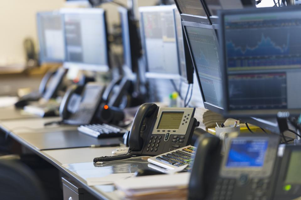 USA, New York, New York City, Trading desk with computers and phones