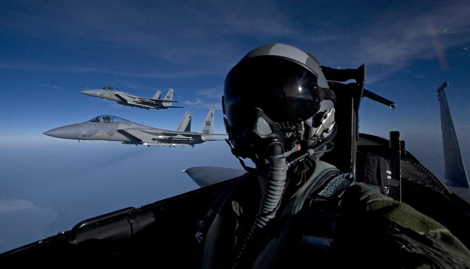 Three F-15 Eagles from the Massachusetts Air National Guard fly high over New England during a training mission.