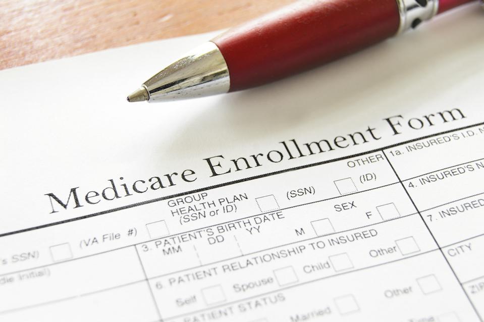 Medicare Enrollment Form and a red pen