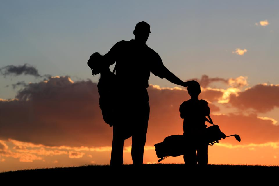 Silhouette of Father and Son on a Golf Course