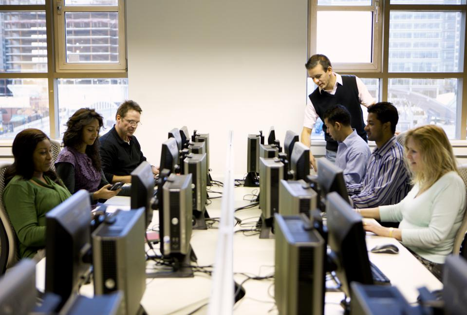 adult education: mature students working in a computer laboratory