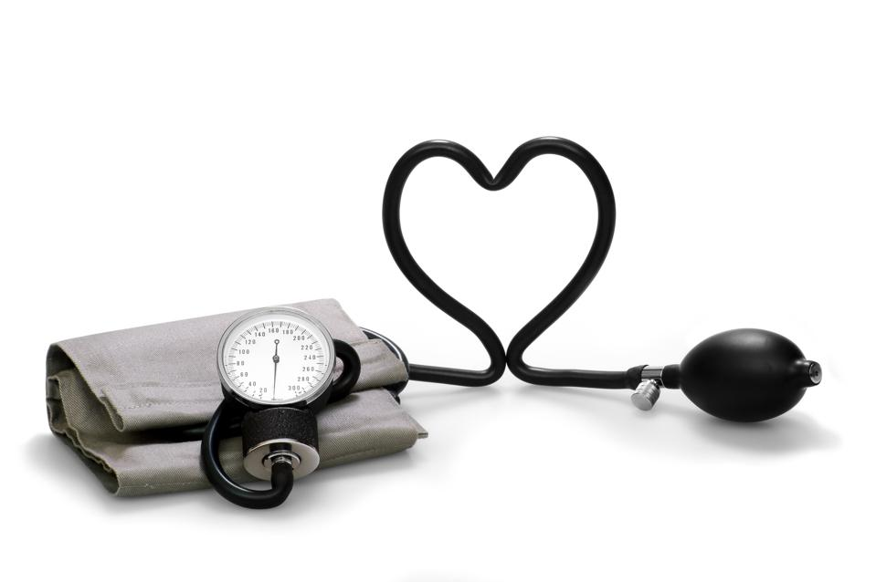 A blood pressure cuff with the black cord forming a heart