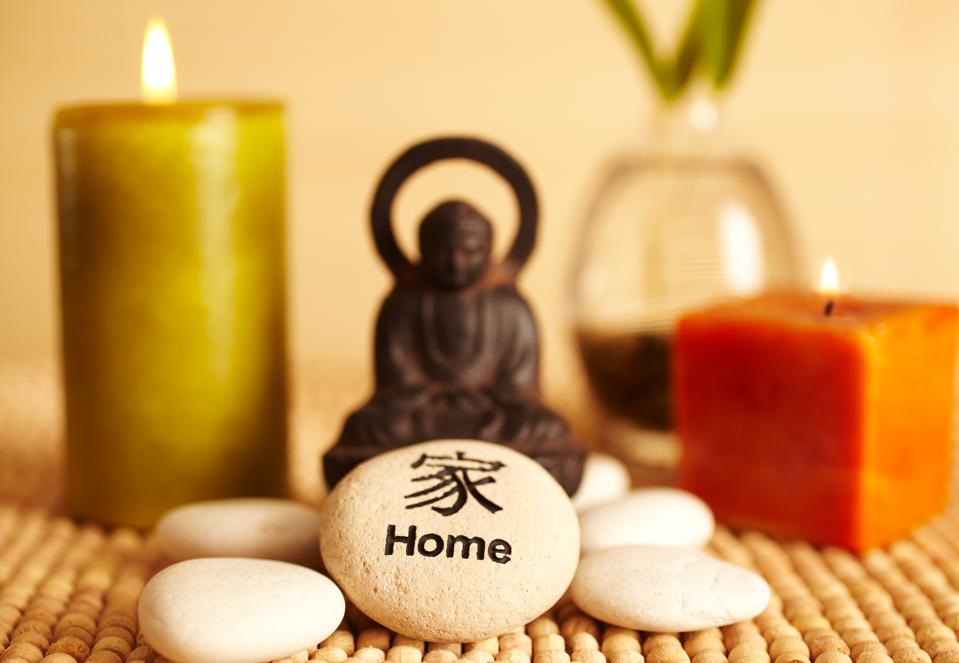 Spa still life buddha statue and candles, home pebble