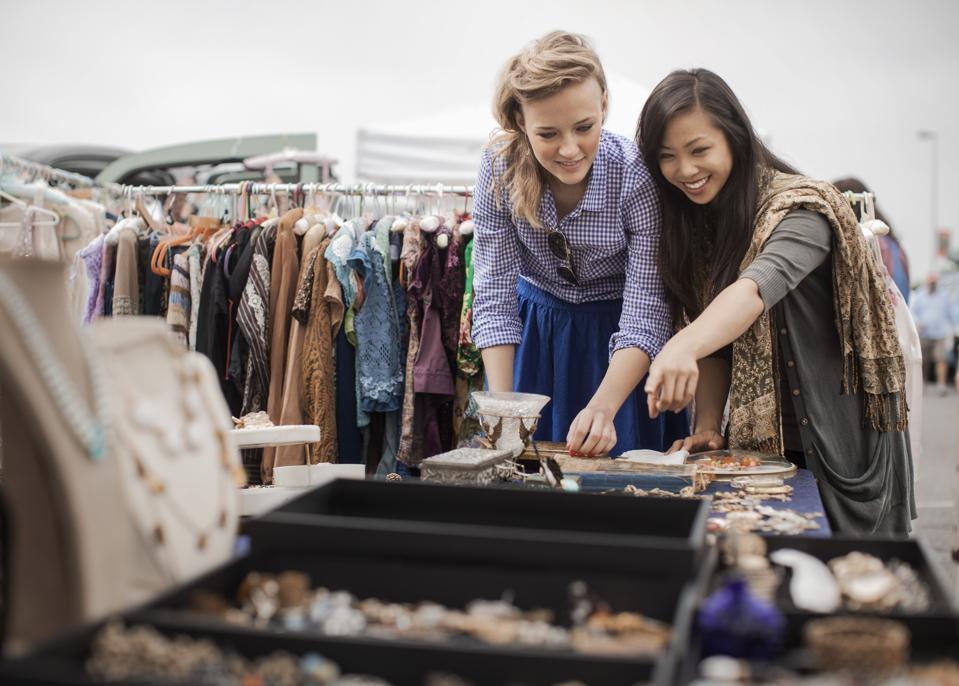 Friends shopping for jewelry in flea market