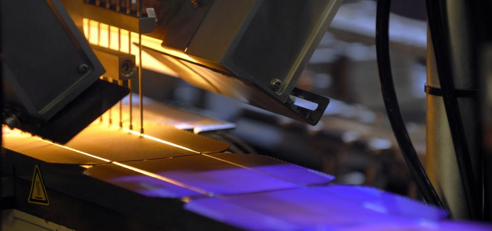 Solar cells wafers as they pass through a machine during the...