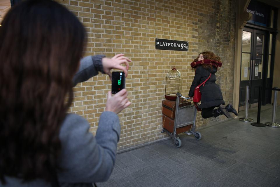 The Harry Potter store in Kings Cross station has a photo opportunity which allows guests to recreate one of the most famous scenes from the movies (Peter Macdiarmid/Getty Images)