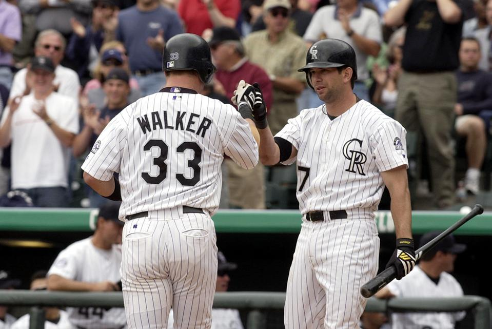 Colorado's Larry Walker, left, and Todd Helton celebrate Walker's home run against San Diego's Brett Tomko in the 5th inning at Coors Field on Thursday. (The Denver Post/ Hyoung Chang)