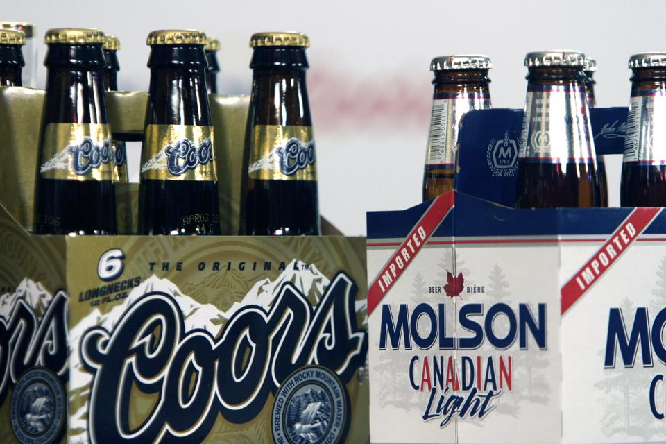 GOLDEN, COLO. - FEBRUARY 1, 2004 - A six-pack of Coors sits by a six-pack of Molson Canadian Light at a press conference after the Coors shareholder meeting at the brewery in Golden Tuesday morning, 2/1/05. (Jerry Cleveland | The Denver Post)