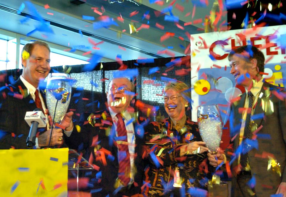 DEVER, COLO. - JANUARY 3, 2006 - Southwest Airlines CEO Gary Kelly<cq>, left, and Denver Mayor John Hickenlooper<cq>, right, use giant champagne glasses to toast the arrival of the first regularly-scheduled Southwest Airlines passenger flight, #2983 from