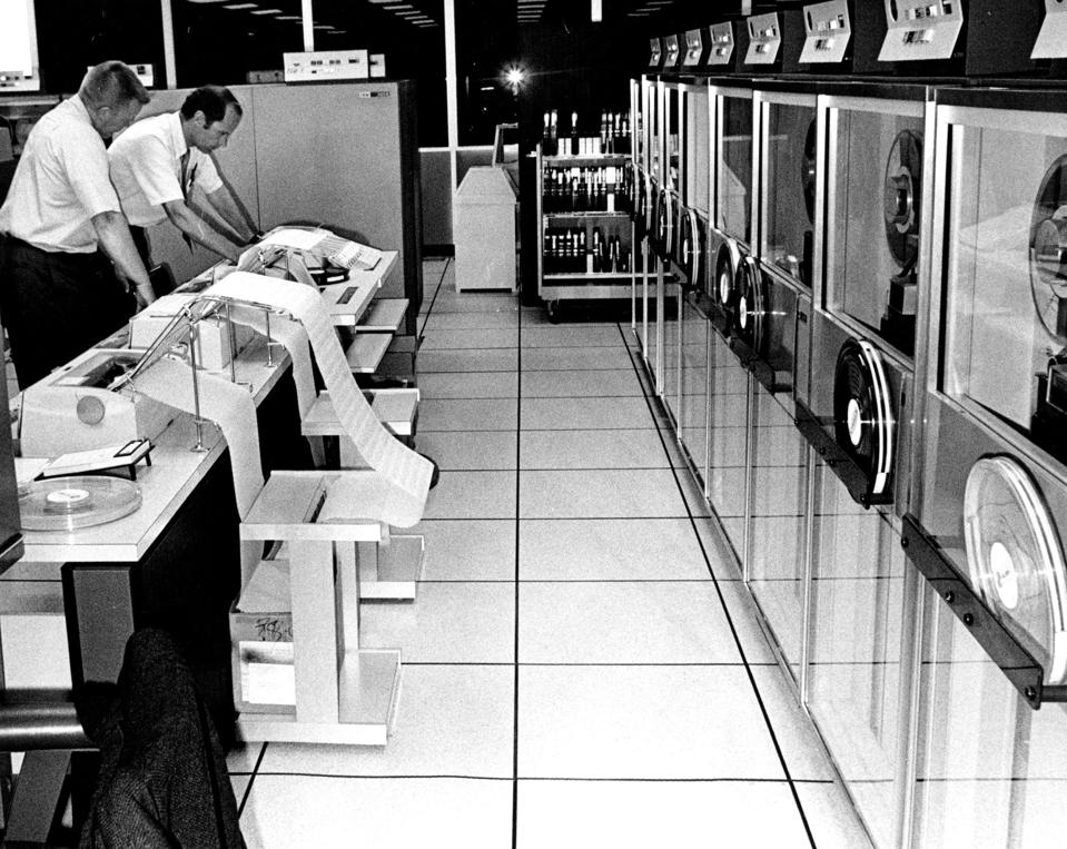 AUG 2 1971; Two specialists check a message in the flight data processing room at the Longmont cente