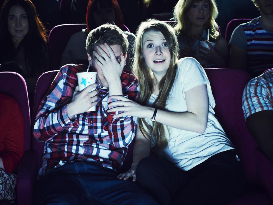 Couple ″enjoying″ a movie at the cinema