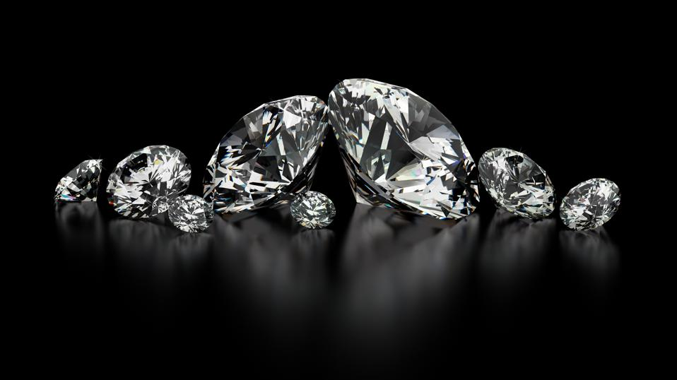Several sizes of diamonds on a black background