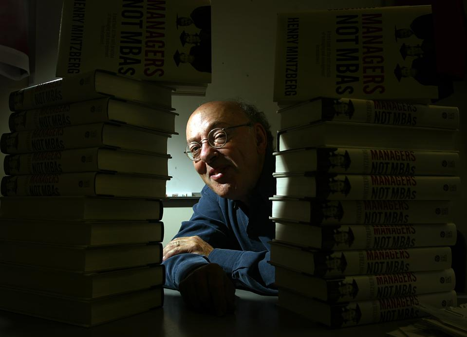 Henry Mintzberg, Cleghorn Porfessor of Management Studies at McGill University poses with his book i