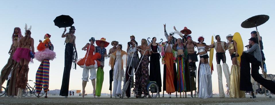 BLACK ROCK DESERT, NV -- Burning Man stilt walkers pose for a group shot after sunset.