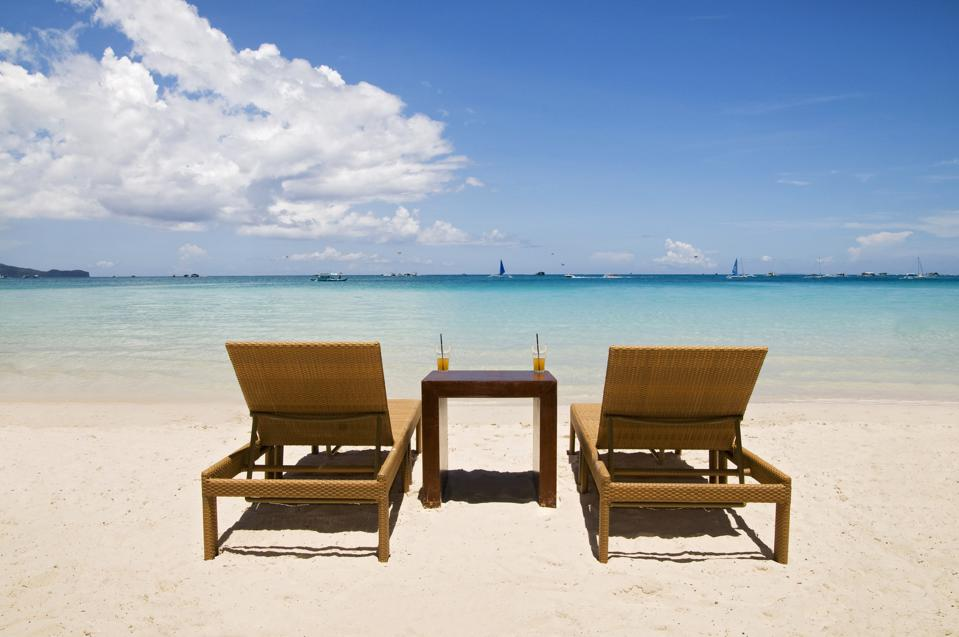 Beach Chairs on White Sand