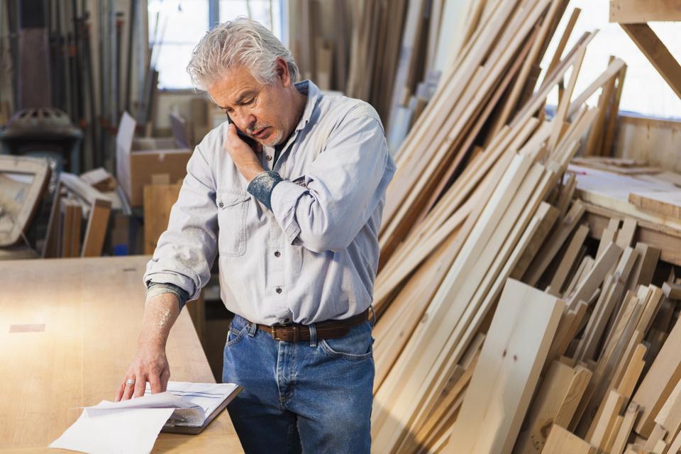 Hispanic craftsman working in studio