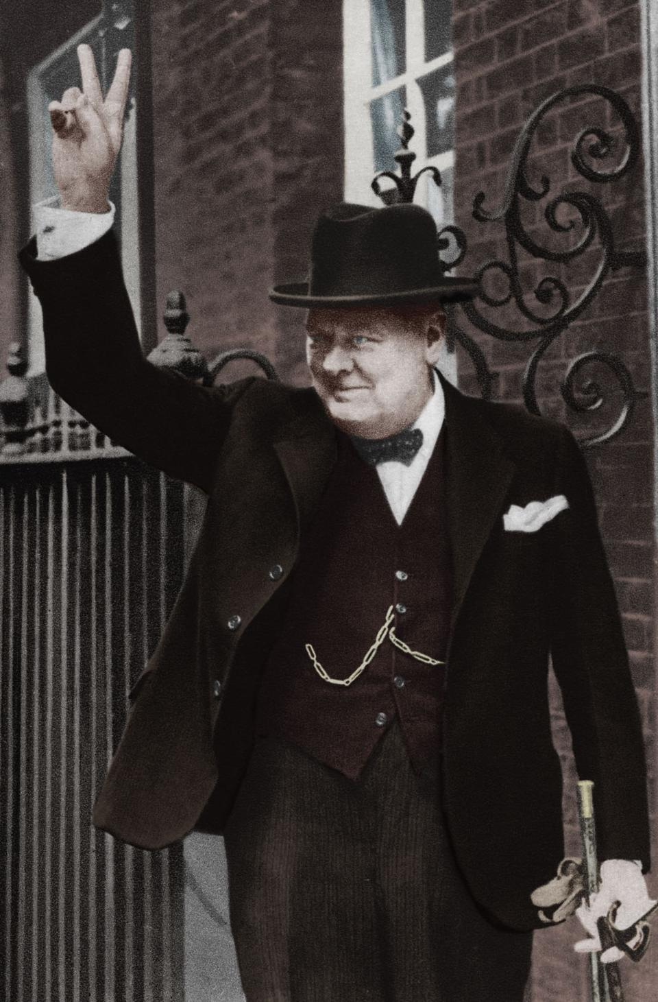 Winston Churchill making the ″V for Victory″ sign outside of 10 Downing Street in June 1943.