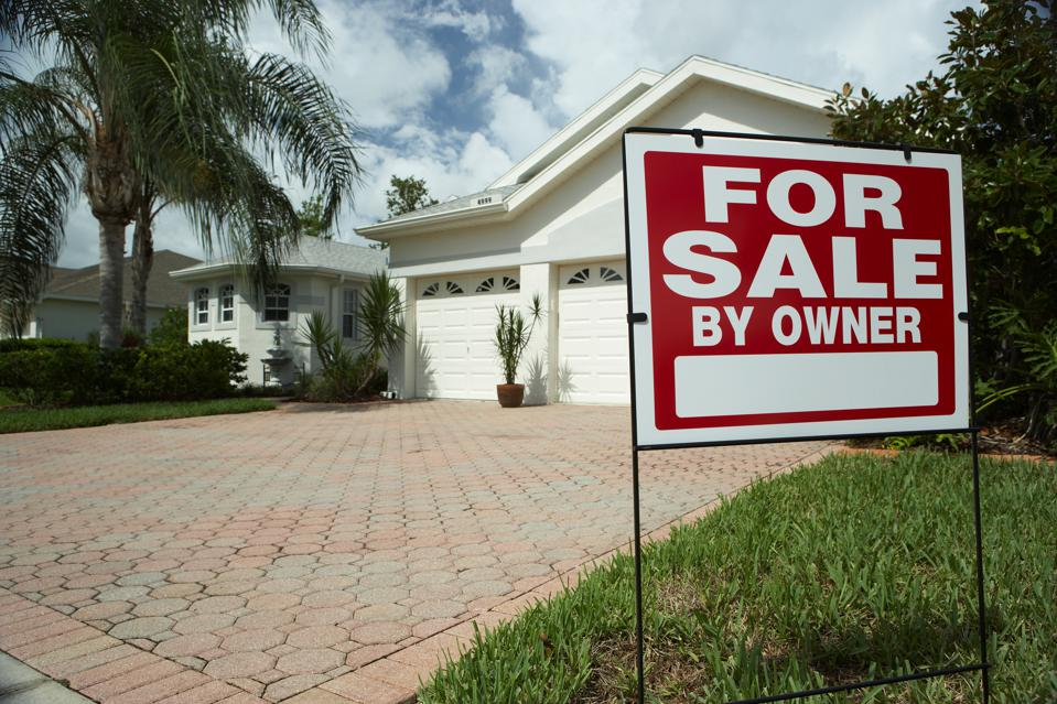 home with a for sale by owner sign out front