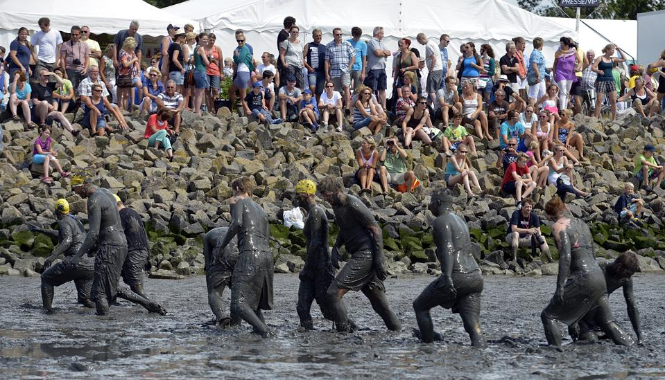 Competitors at the Mud Olympics in Germany