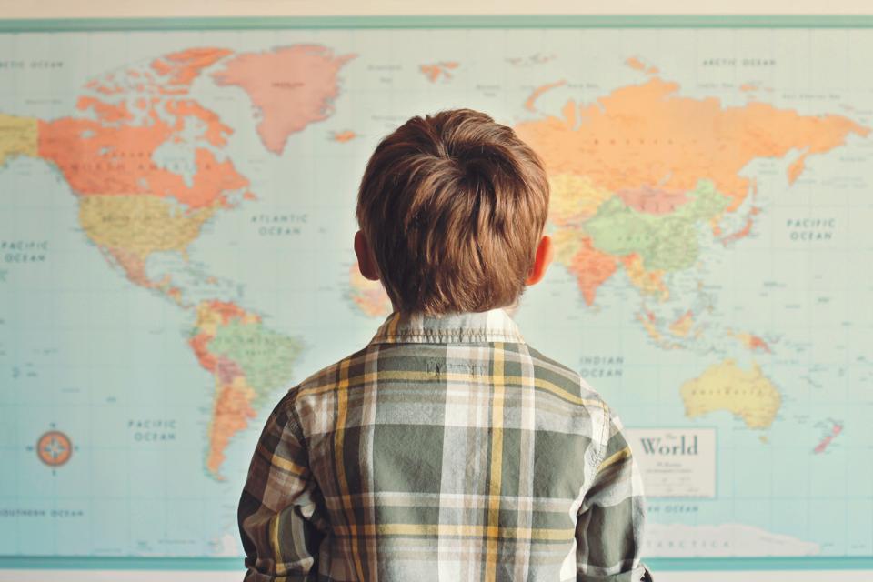 Kid looking at a map