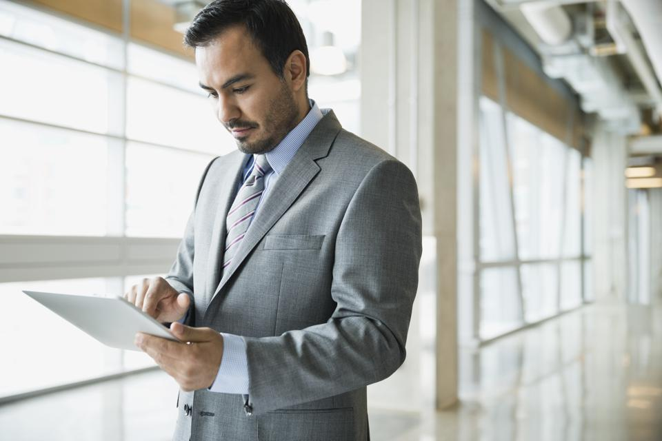 Businessman using digital tablet in office building