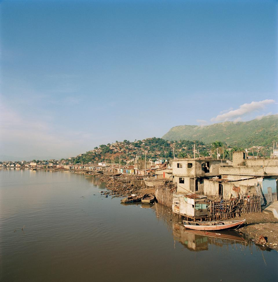 Houses built on the river banks at Cap-Haitien on the north coast of Haiti