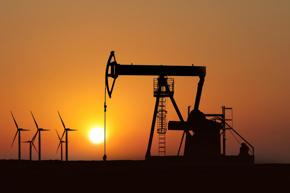 oil pump silhouette in sunset and alternative energy