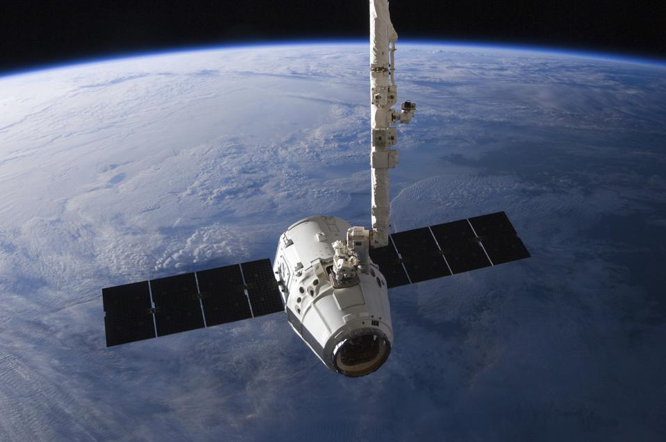 The SpaceX Dragon cargo craft prior to being released from the Canadarm2.