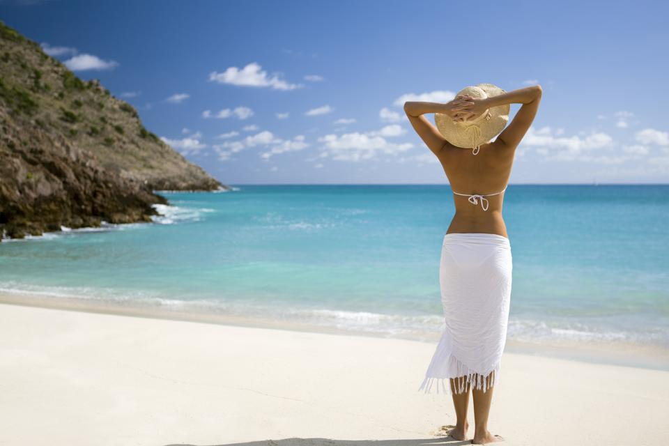 Woman vacationing at tropical beach in Caribbean