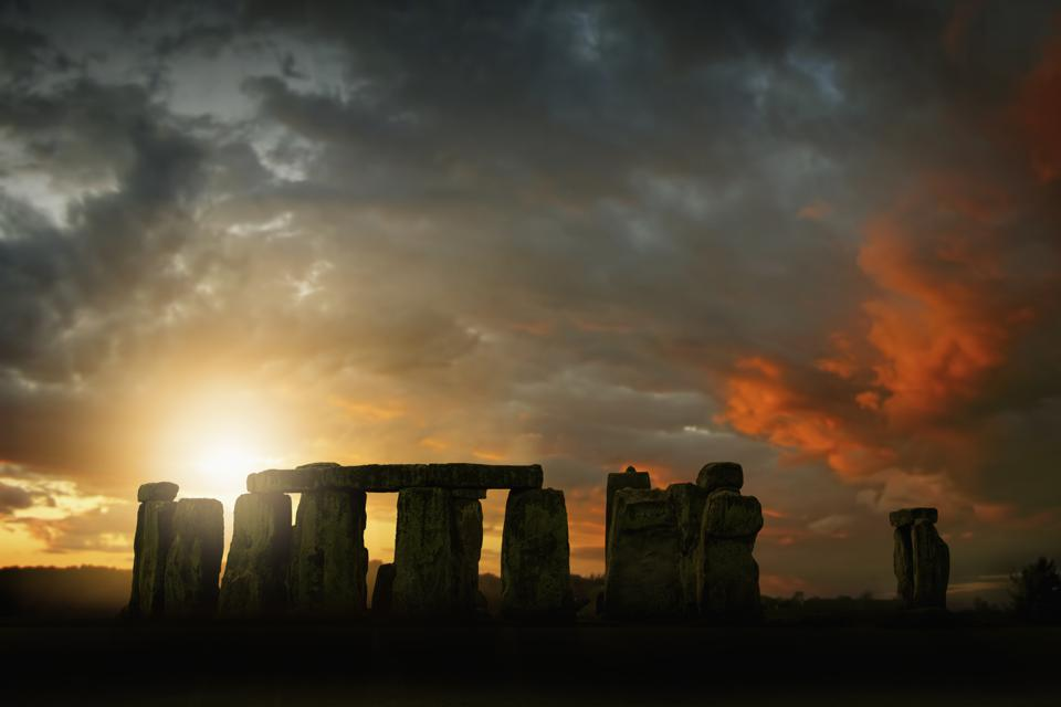 Sun rising over Stonehenge, Wiltshire, United Kingdom