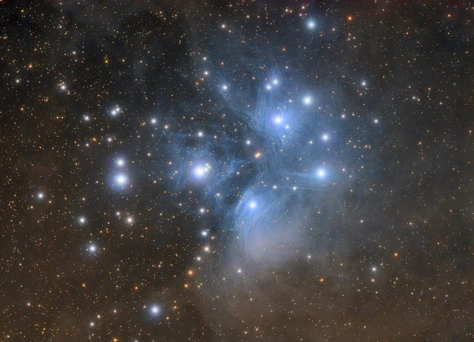 Pleiades open star cluster with nebula (Messier 45) in constellation of Taurus photographed with high quality amateur telescope.