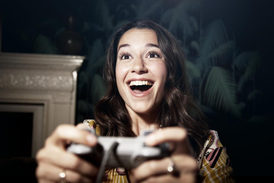 Woman winning a computer game.