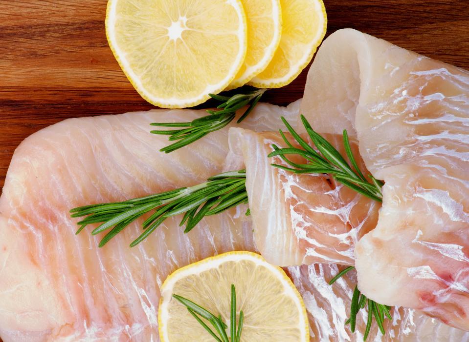 Arrangement of raw cod fillets.