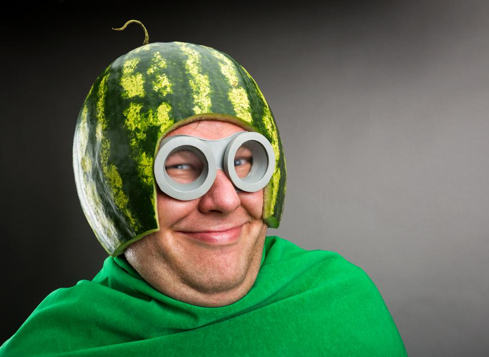 Funny man with watermelon helmet and goggles
