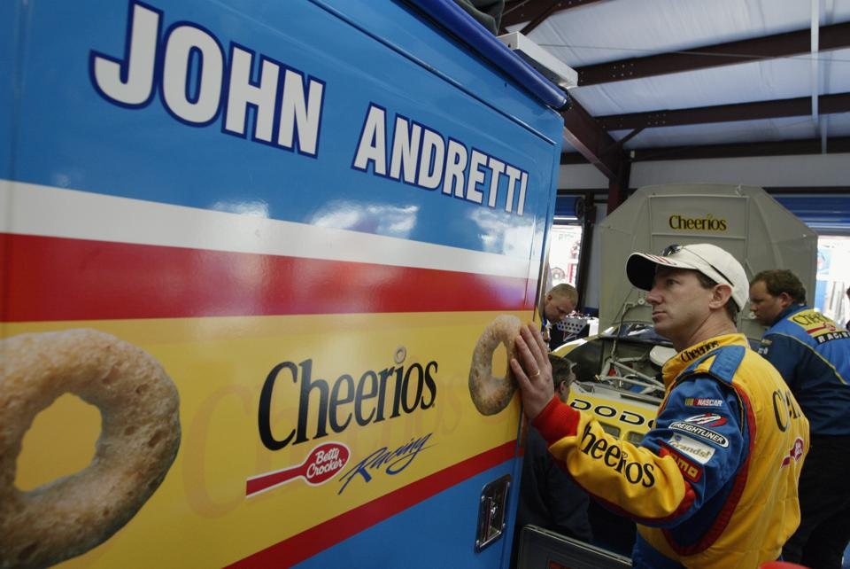 John Andretti stood by his No. 43 car during practice.