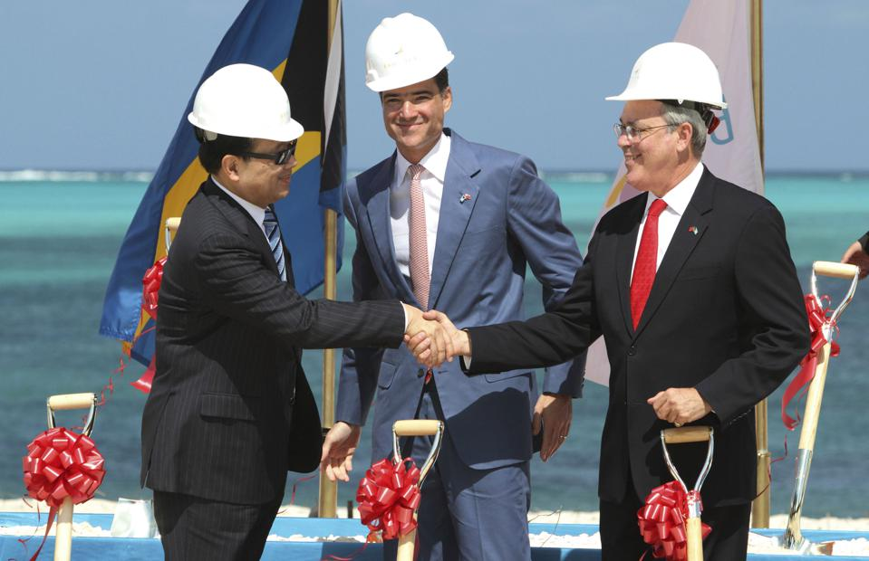 At the early 2011 groundbreaking for the yet-to-open largest resort in the Caribbean, Baha Mar Resorts CEO Sarkis Izmirlian stands between state-owned Export-Import Bank of China President Li Ruogu, left, and Bahama's Deputy Prime Minister Brent Symonette, before the two governments squeezed him out. (Photo Credit: AP Photo/Tim Aylen)