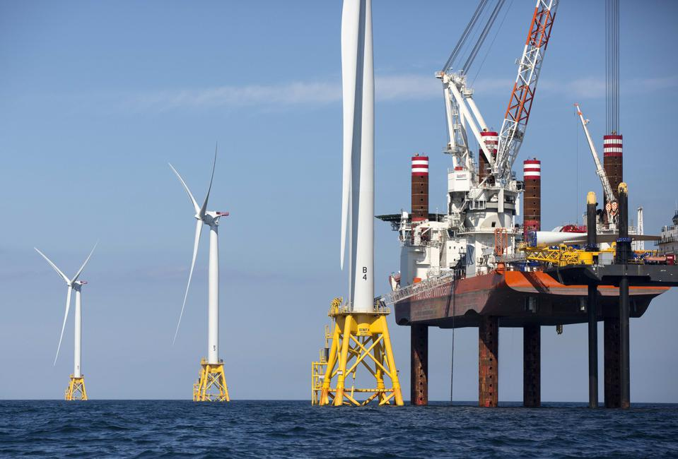A lift boat, that serves as a work platform, assembles a wind turbine off Block Island, R.I. Massachusetts.