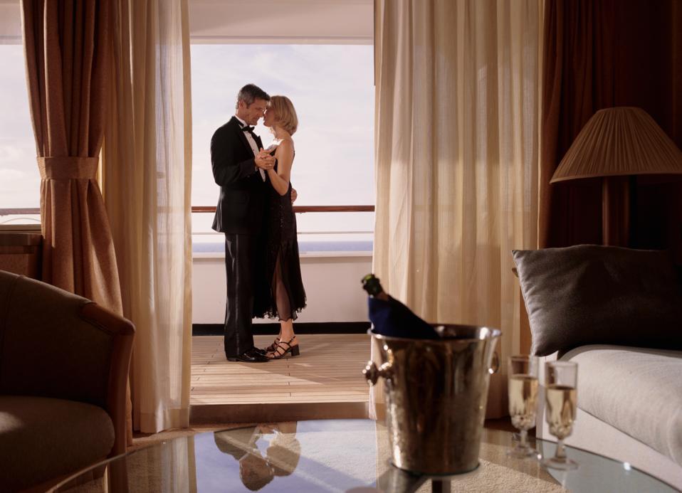 Elegant couple embracing in cruise ship cabin