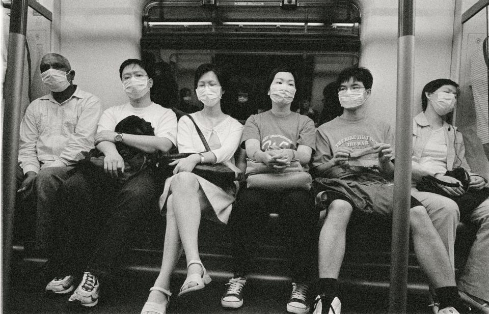 Photo of people in Hong Kong, China, riding the subway during the SARS outbreak. SARS is another type of coronavirus that causes respiratory symptoms in humans.