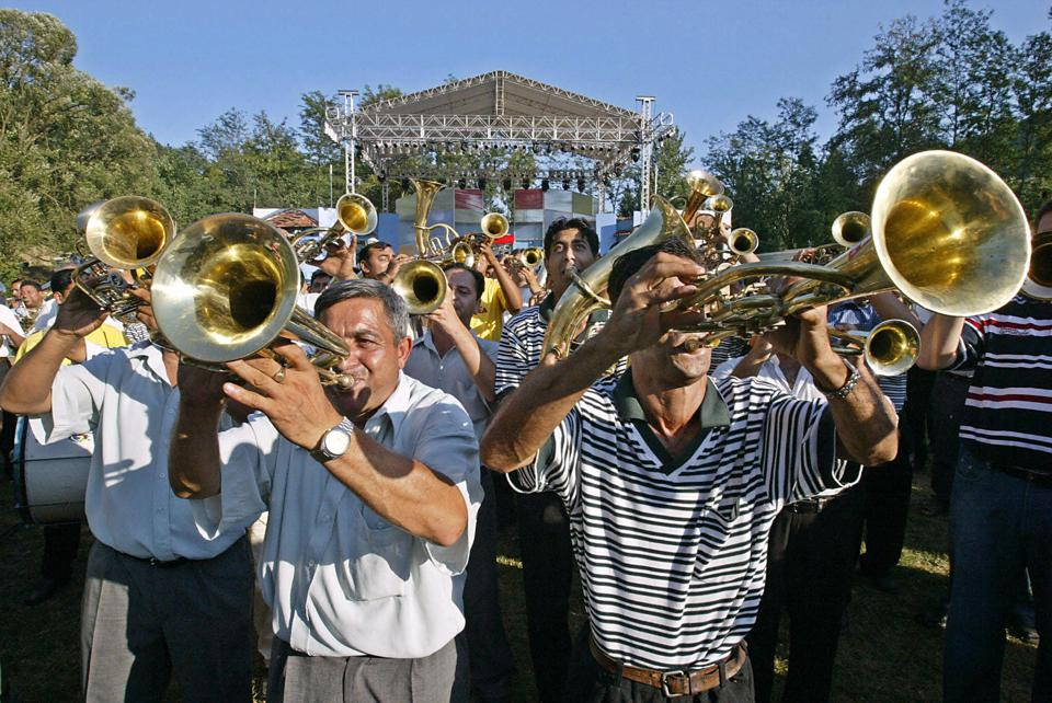 Serbian and Roma brass bands rehearse th