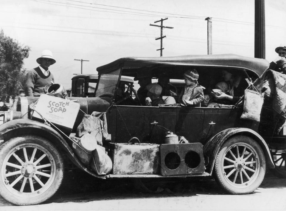 Refugees crowded into a car fleeing the Dust Bowl of the 1930s.