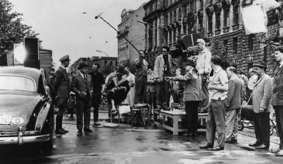 Austrian-born filmmaker Billy Wilder directs a scene with American actor on the set of Wilder's film, 'One, Two, Three,' West Berlin