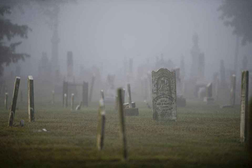 Grave markers stand in the Waterloo City Cemetery in Waterloo, Illinois, U.S., on Monday, Sept. 30, 2013. The Waterloo Cemetery district, a special purpose district with the authority to levy taxes on local residents, spent $16,000 in 2011, and maintained a cash balance of $775,000. Across the nation, there are 37,200 so-called special purpose districts, four of every 10 local governments. SincePresident Ronald Reagan declared in his 1981 inaugural addressthat government is not the solution to our problem -- government is the problem, their numbers have jumped 32 percent.