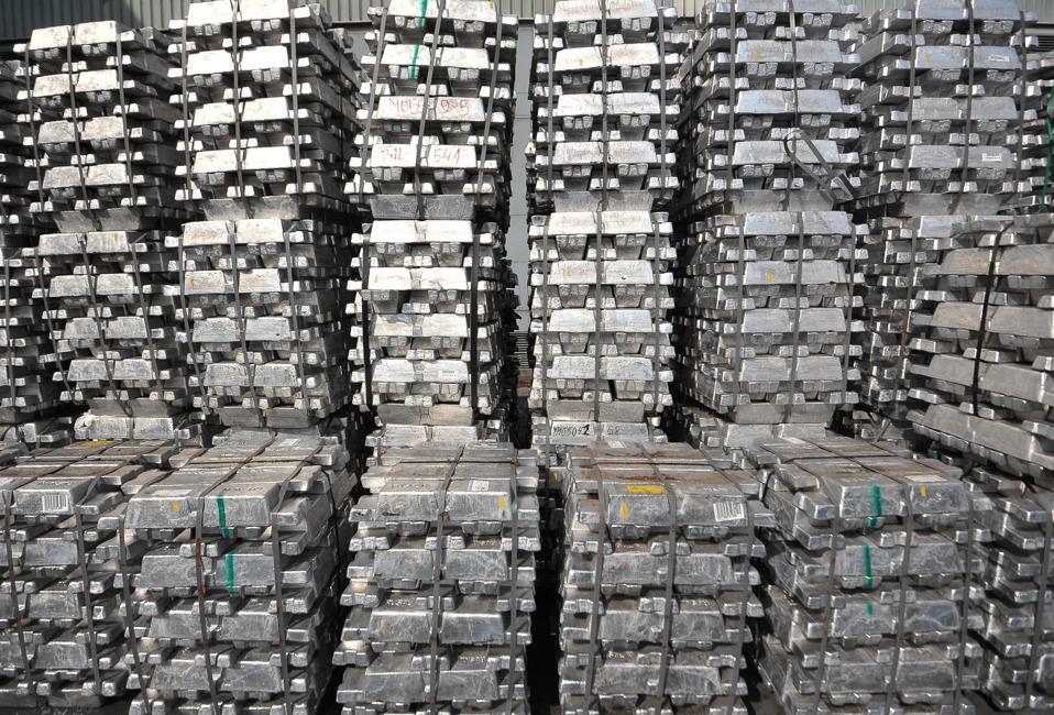 Stacks of newly moulded aluminum ingots.