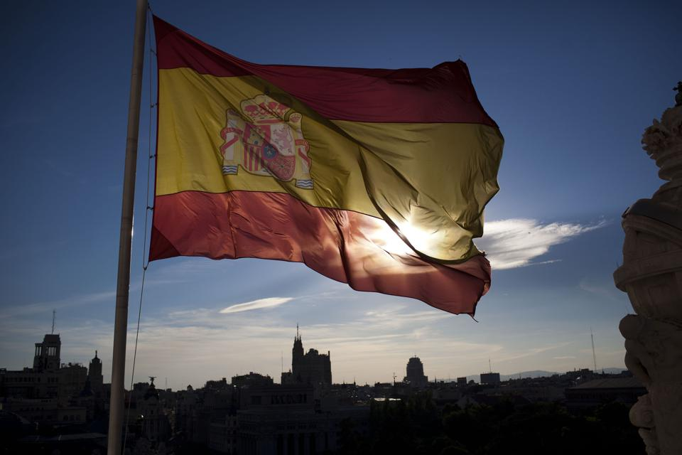 National Flags Above City Hall As Spain Suffers Highest EU Unemployment Rate