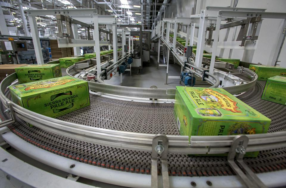 Cases of Pale Ale cans move along a conveyor belt at the Sierra Nevada Brewing facility in Chico, California. The company ranks No. 3 in craft beer sales volume in the United States.