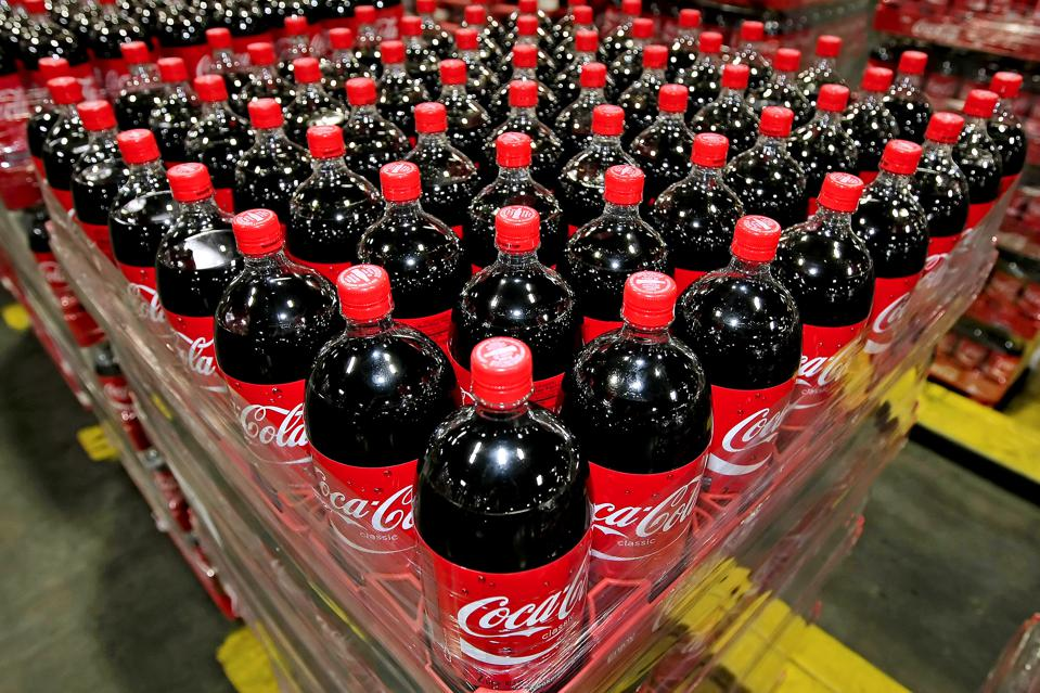 Pallets of Coca-Cola bottles sit in a warehouse. Photographer: George Frey/Bloomberg News