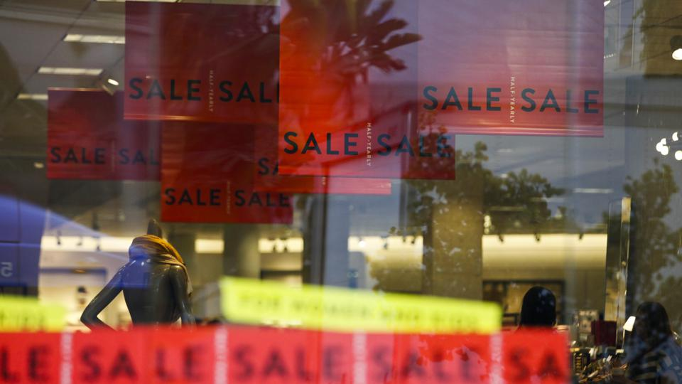 Red sale signs hang in a Nordstrom store in Santa Monica, California,